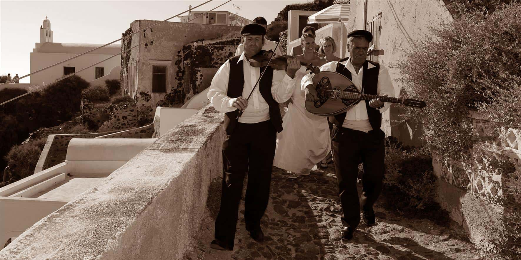 musicians walking with bride