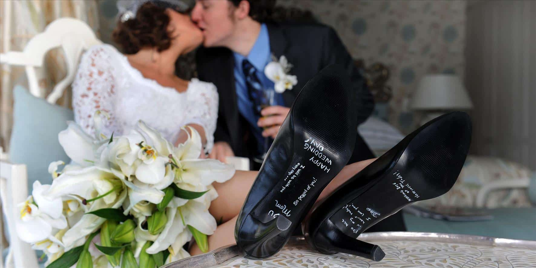 wedding couple kissing high heels