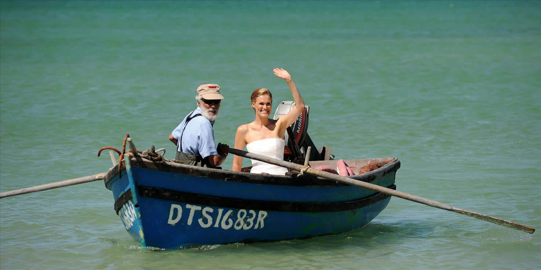 bride entering on row boat
